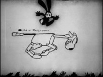 "Oswald has to jump off ""The Mechanical Cow"" to narrowly miss gangster gunfire."
