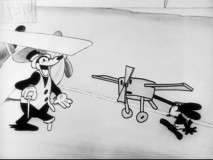 "Pegleg Pete scoffs at Oswald's tiny plane like only a bad guy would in ""The Ocean Hop."""