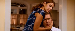 Allen's doctor wife (Eva Mendes) comforts him while he (Will Ferrell) is haunted by his past life.