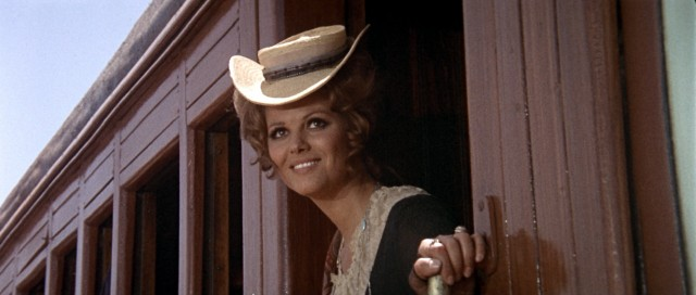 Smiling Jill McBain (Claudia Cardinale) steps off her train, expecting to be taken to her new family in Sweetwater.