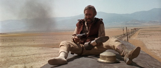Sitting atop a moving train, wanted bandit Cheyenne (Jason Robards) pulls the gun out of his boot, having successfully pulled off the old gun-in-boot trick.