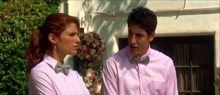 Jason Biggs' character Dan is okay wearing a pink shirt and bow tie. Why wouldn't he be, playing a gay best friend/caterer?