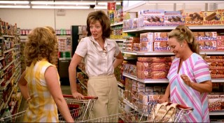 Joan gets some grocery store solace from her two best friends, Sally (Cheryl Hines) and Sheila (Allison Mackie).
