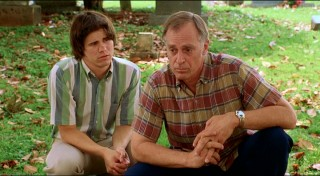 "The older brother from ""Joan of Arcadia"" and the father from ""Andre"" share an uneasy moment at the cemetery."