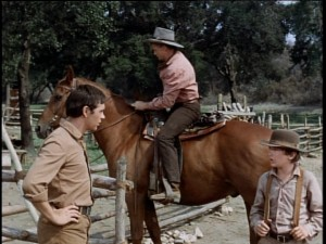 Beck's (Brian Keith, center) arrival doesn't completely ease tensions between Travis and Arliss.