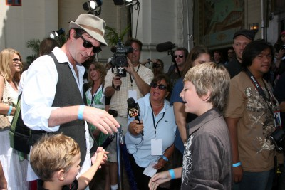 Noah Wyle oversees a hand-shaking with Parker Goris (voice of Flounder).