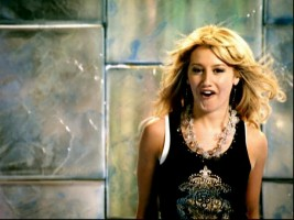 "Ashley Tisdale, of ""The Suite Life of Zack & Cody"" and ""High School Musical"" covers ""Kiss the Girl"" in the set's lone music video."