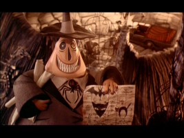 Still from The Nightmare Before Christmas: 2000 Special Edition DVD - click to view screencap in full 720 x 480. Halloween Town's two-faced Mayor excitedly holds his plans for next Halloween.