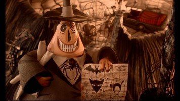 Still from The Nightmare Before Christmas: 2008 Collector's Edition DVD - click to view screencap in full 720 x 480. Halloween Town's two-faced Mayor excitedly holds his plans for next Halloween.