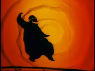 A silhouetted Oogie Boogie dances against a swirling orange background in one of the shorter deleted scenes.