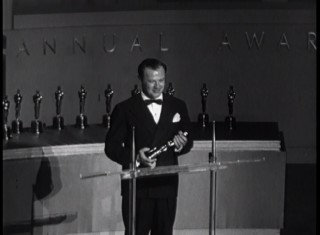 "The Fox Movietone newsreel on the 1950 Oscars ceremony abruptly ends after announcing Joseph L. Mankiewiecz's double wins for writing and directing ""Three Wives."""