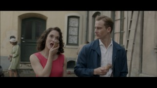 Marlene (Friederike Becht) and Johann (Alexander Fehling) enjoy a walk and talk with chocolate ice cream cones in this deleted scene.