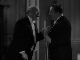 """Judge"" Blake/Mr. E. Worthington Manville (Guy Kibbee) can't resist a little billiards hustling of visiting dignitary Count Alfonso Romero (Walter Connolly)."
