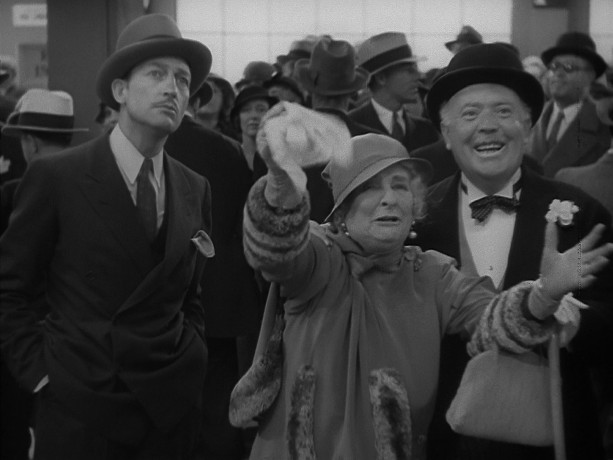 Dave the Dude (Warren William), Apple Annie (May Robson), and Judge Blake (Guy Kibbee) are at the dock and looking spiffy to greet Annie's illegitimate daughter and her company.
