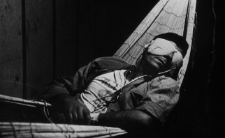 "In ""La Jet�e"", a man (Davos Hanich) journeys back in time with this blindfolded hammock recline."