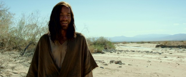 "Jesus (Ewan McGregor) laughs at a boy's fart in ""Last Days in the Desert."""