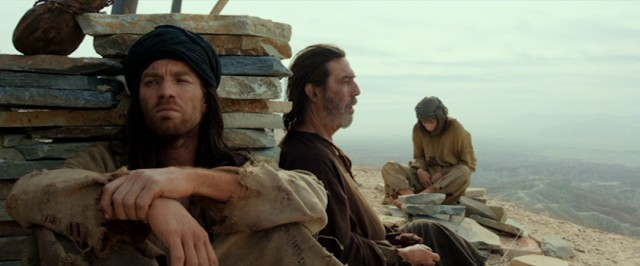 Jesus' (Ewan McGregor) desert solitude is broken by a boy who loves riddles (Tye Sheridan) and a father who doesn't (Ciarán Hinds).