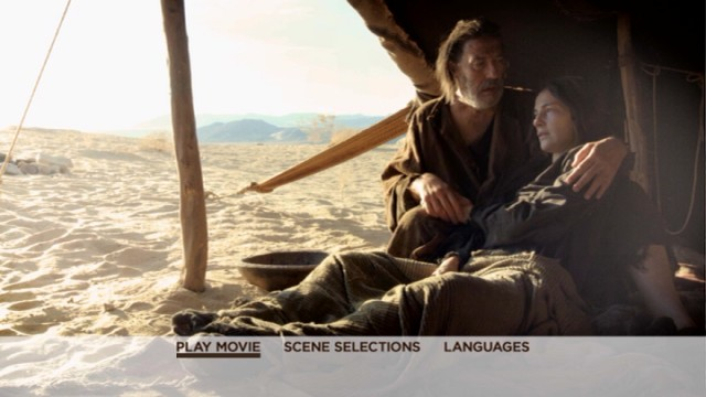 The Father (Ciaran Hinds) comfort his sick wife (Ayelet Zurer) on the basic menu of the Last Days in the Desert DVD.