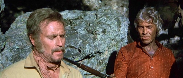 "After a movie spent pursuing each other, Charlton Heston and James Coburn finally come face to face...or is that grizzly beard to shotgun barrel in ""The Last Hard Men&.quot;"