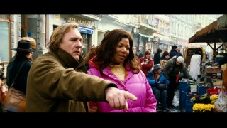 "Famed French chef Didier (Gérard Depardieu) shows Georgia Byrd (Queen Latifah) a Czech food market in ""Last Holiday."""