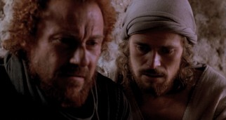 Jesus (Willem Dafoe) asks a large favor (betrayal) of his closest apostle, the curly-haired, red-bearded Judas Iscariot (Harvey Keitel).