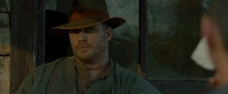 With fresh stitches in his throat, eldest brother and leader Forrest Bondurant (Tom Hardy) shoots a glare.