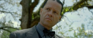 Guy Pearce is almost unrecognizable in the grotesque villain's role of Special Deputy Charley Rakes.