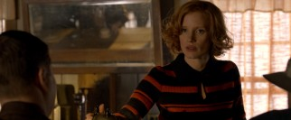 The loyal Maggie Beauford (Jessica Chastain) tends the bar out of which the Bondurants run their moonshining business.