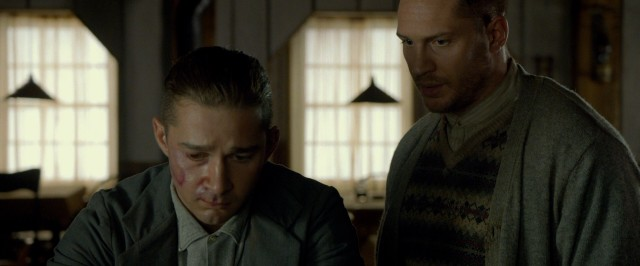 A freshly and badly bruised Jack Bondurant (Shia LaBeouf) gets some wisdom from his big brother Forrest (Tom Hardy).