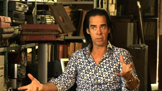 "Screenwriter and composer Nick Cave gives his perspective in his loudly-dressed appearance in ""The True Story of the Wettest County in the World."""