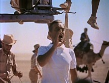 "While making movie history, David Lean shouts direction in ""Wind, Sand and Star."""