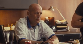 Bruce Willis is Dink Heimowitz, a legendary Las Vegas sports gambler who hires Beth to place bets for him.