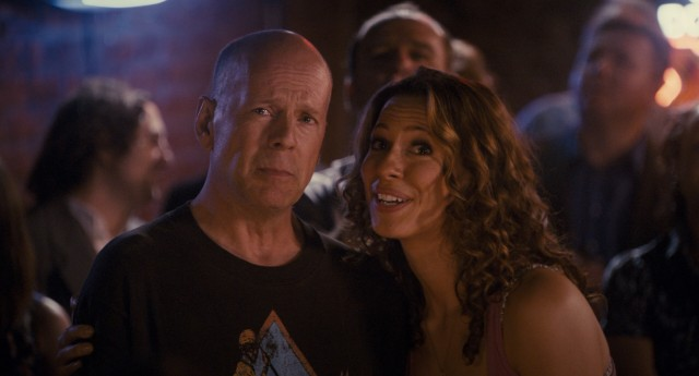 Naturally, everyone's future rides on one fictional sports game, which Dink (Bruce Willis) and Beth (Rebecca Hall) watch together in the company of friends.