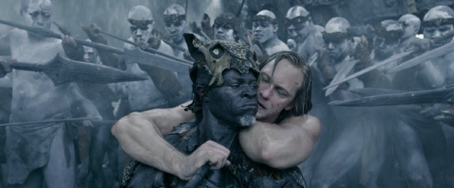 Though surrounded by spears, Tarzan (Alexander Skarsgård) puts Chief Mbonga (Djimon Hounsou) in a compromising position.