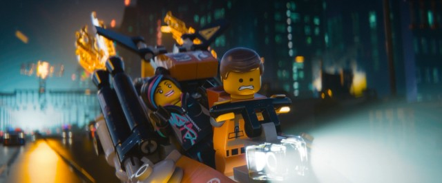 "Wyldstyle (a.k.a. Lucy) and Emmet Brickowski try to elude authorities and cross into another world in ""The LEGO Movie."""