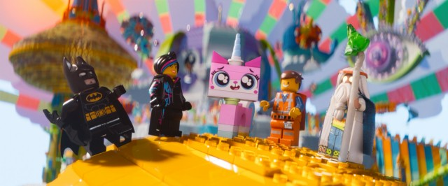 Unikitty welcomes Batman, Wyldstyle, Emmet, and Vitruvius to the colorful and cheerful Cloud Cuckoo Land.