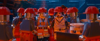 Emmet and Lucy try to blend in among robotic factory workers.