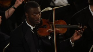 "Hardison (Aldis Hodge) plays the violin but wishes he wasn't in ""The Scheherazade Job."""