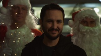 Wil Wheaton is surprisingly effective as a villain, even when flanked by festive Santas.