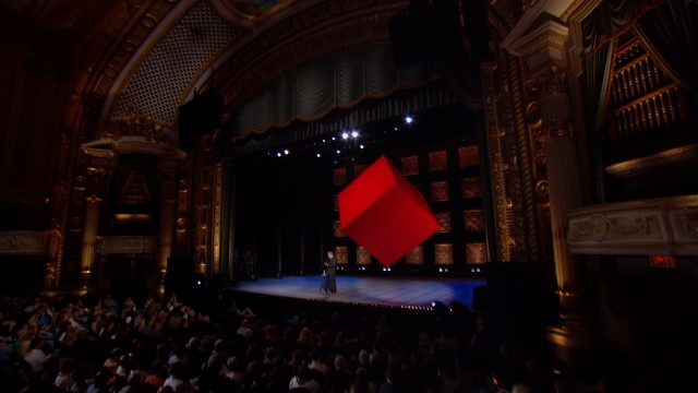This long shot gives us a good look at the suspended red cube which adorns the stage at the State Theatre in Minneapolis for Lewis Black's 2011 show.