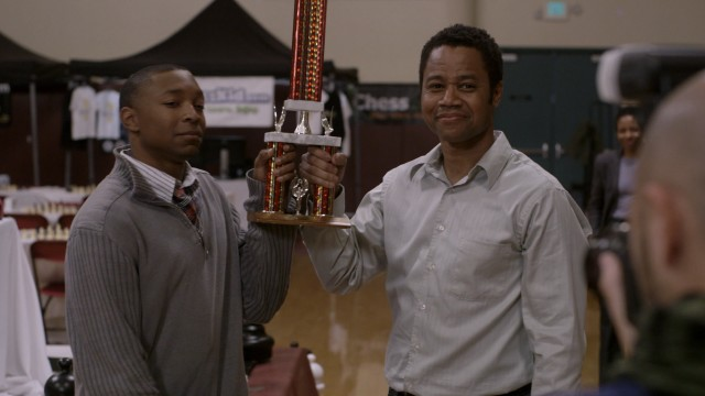 "Spoiler alert: Tahime (Malcolm Mays) and Mr. Brown (Cuba Gooding, Jr.) lift a second place trophy at the end of the climactic chess tournament of ""Life of a King."""
