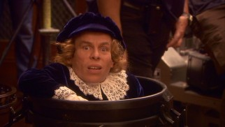 Warwick Davis finds himself in the demeaning position of hiding in a garbage can to stand-in for a child actor across from Helena Bonham Carter.