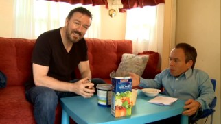 Ricky Gervais pops in for an unannounced visit to Warwick Davis' trailer in this Behind-the-Scenes short.