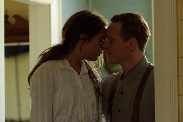 "Real-life couple Michael Fassbender and Alicia Vikander play Tom and Isabel Sherbourne, who find happiness as lighthouse keepers on a remote island in ""The Light Between Oceans."""