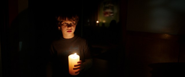 "A boy (Gabriel Bateman) with a candle is surely in no danger at all in a movie called ""Lights Out."""