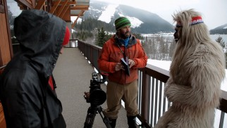 Documentarians chat with a Yeti in one of the film's very few non-skiing moments.