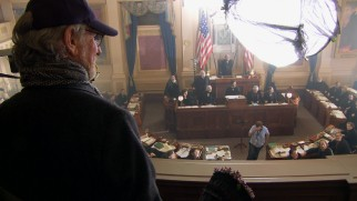 His Eminence, Steven Spielberg, smiles over the Richmond, Virginia set transformed to depict the 1865 House of Representatives.