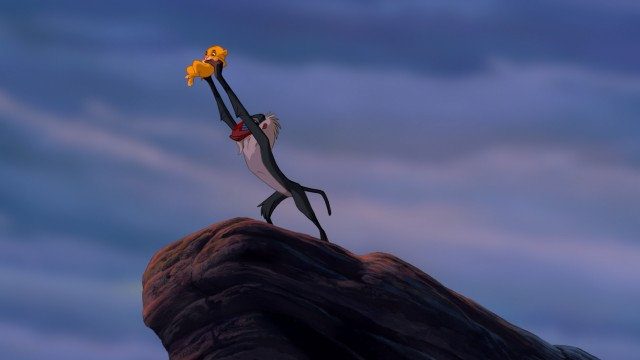 "Rafiki presents the newborn Simba in the powerful and iconic ""Circle of Life"" opening to the film."