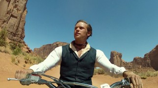 "Armie Hammer dirt bikes around America's Southwest in costume in ""Armie's Western Road Trip."""