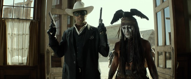"Sometimes, good guys have to rob a bank, as The Lone Ranger (Armie Hammer) and Tonto (Johnny Depp) demonstrate in Disney's ""The Lone Ranger."""